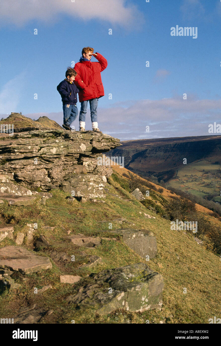 WOMAN IN RED COAT AND YOUNG BOY WALKERS ON THE BLACK HILL HEREFORDSHIRE UK - Stock Image