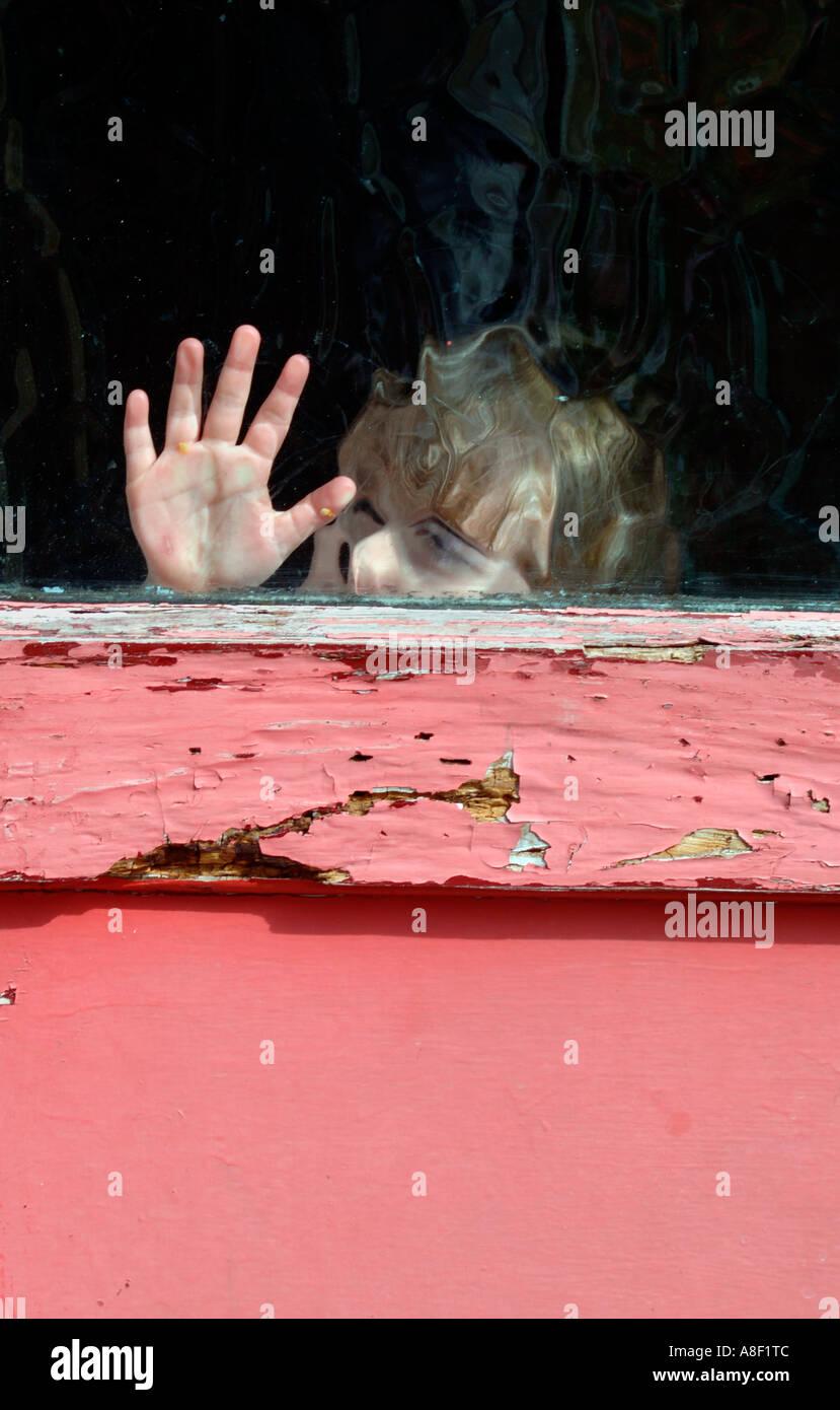 Little Girl Behind Glass Door - Stock Image