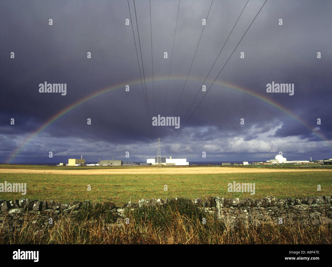 dh  DOUNREAY CAITHNESS Nuclear atomic reactor electricity power station lines rainbow black cloud - Stock Image