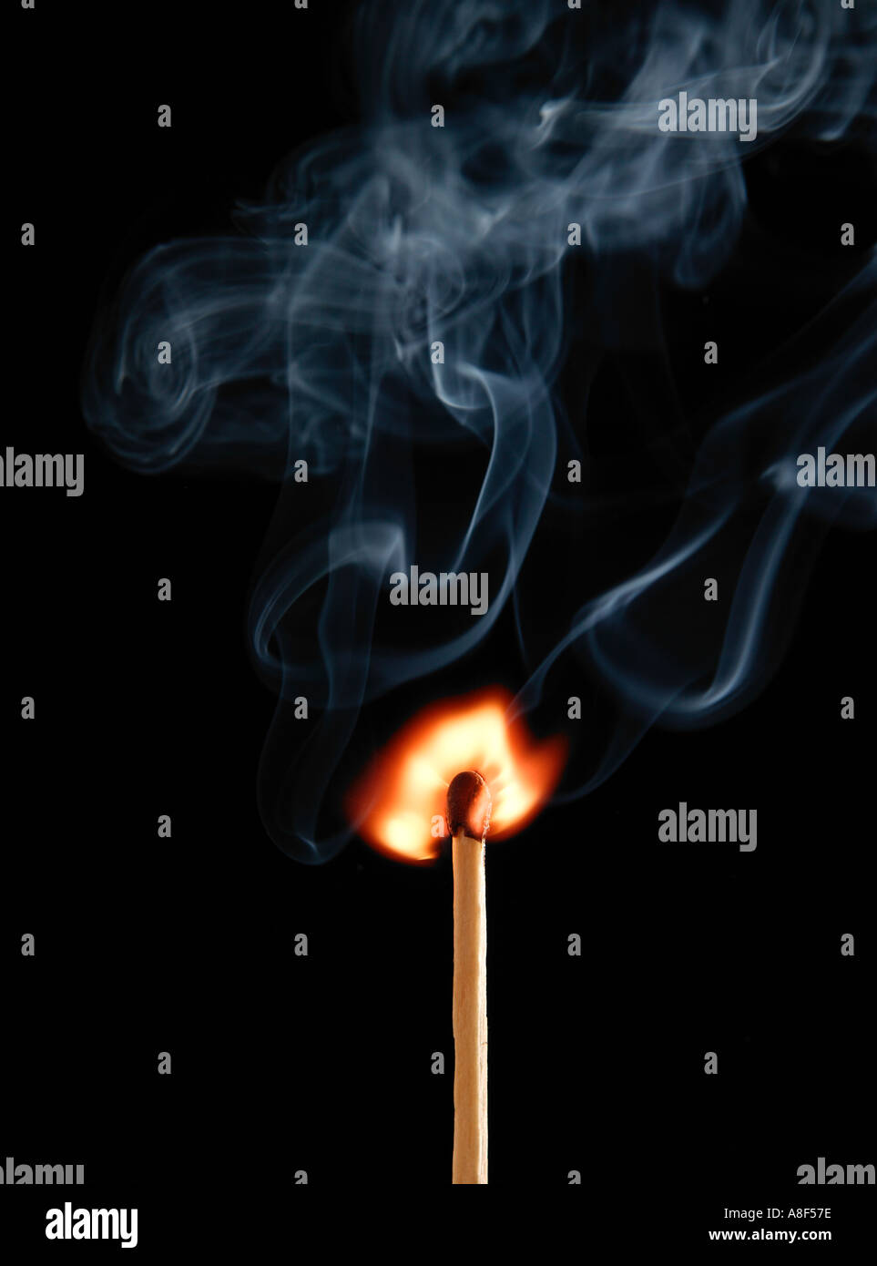 MATCH FLAME AND SMOKE ON BLACK BACKGROUND - Stock Image