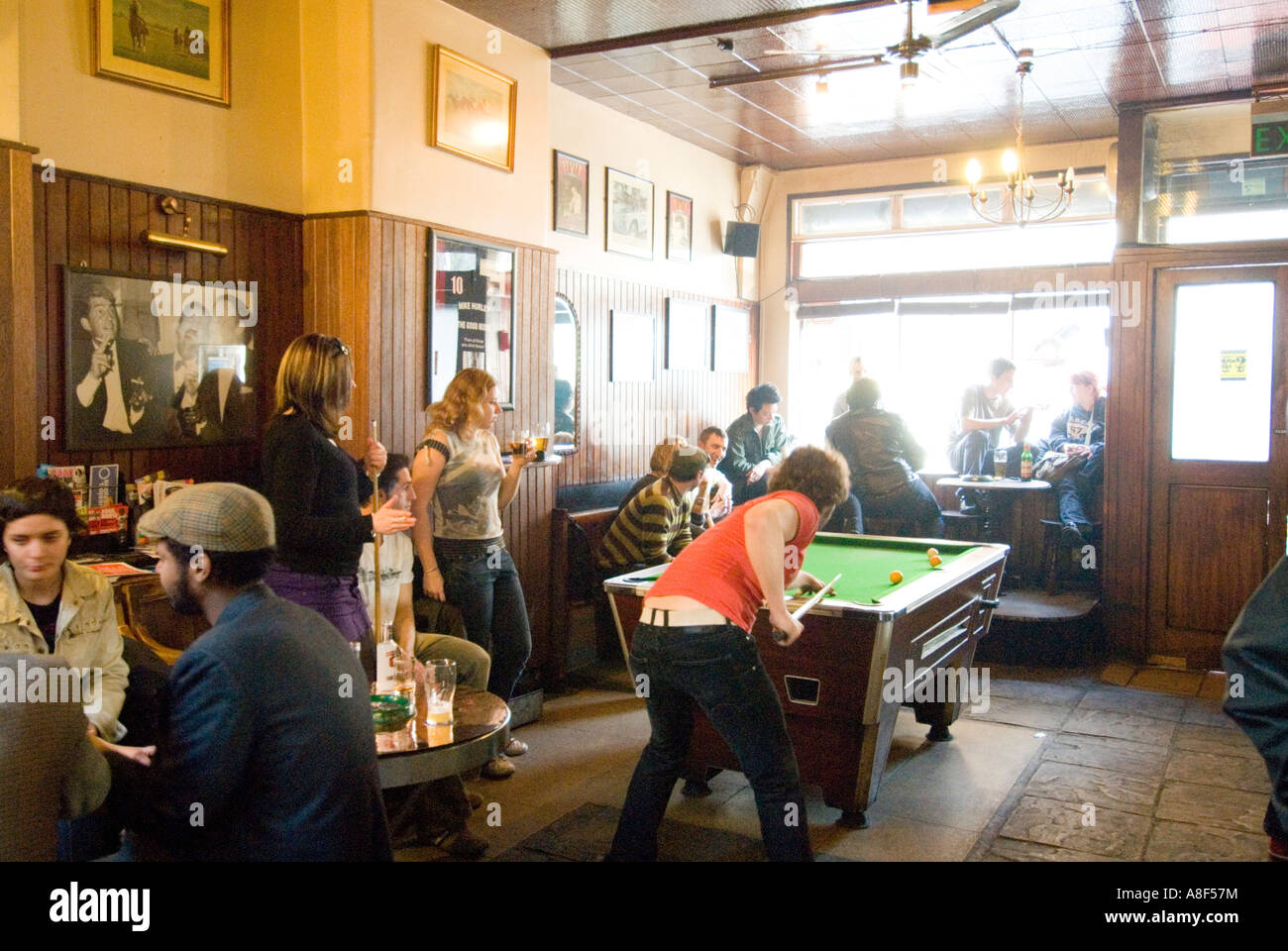 People inside trendy pub The Good Mixer in Camden Town, London England UK - Stock Image