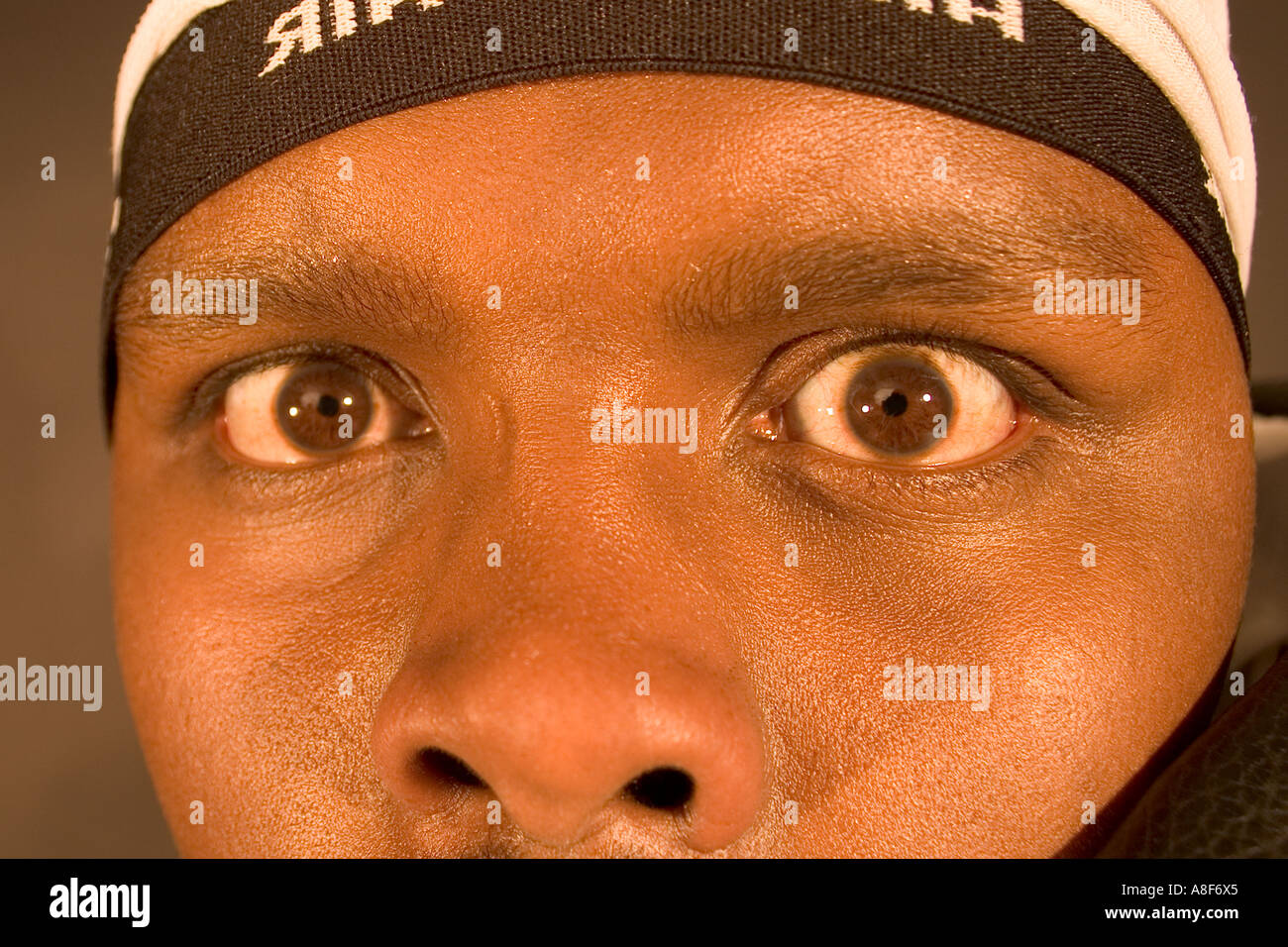 Black man staring into camera - Stock Image