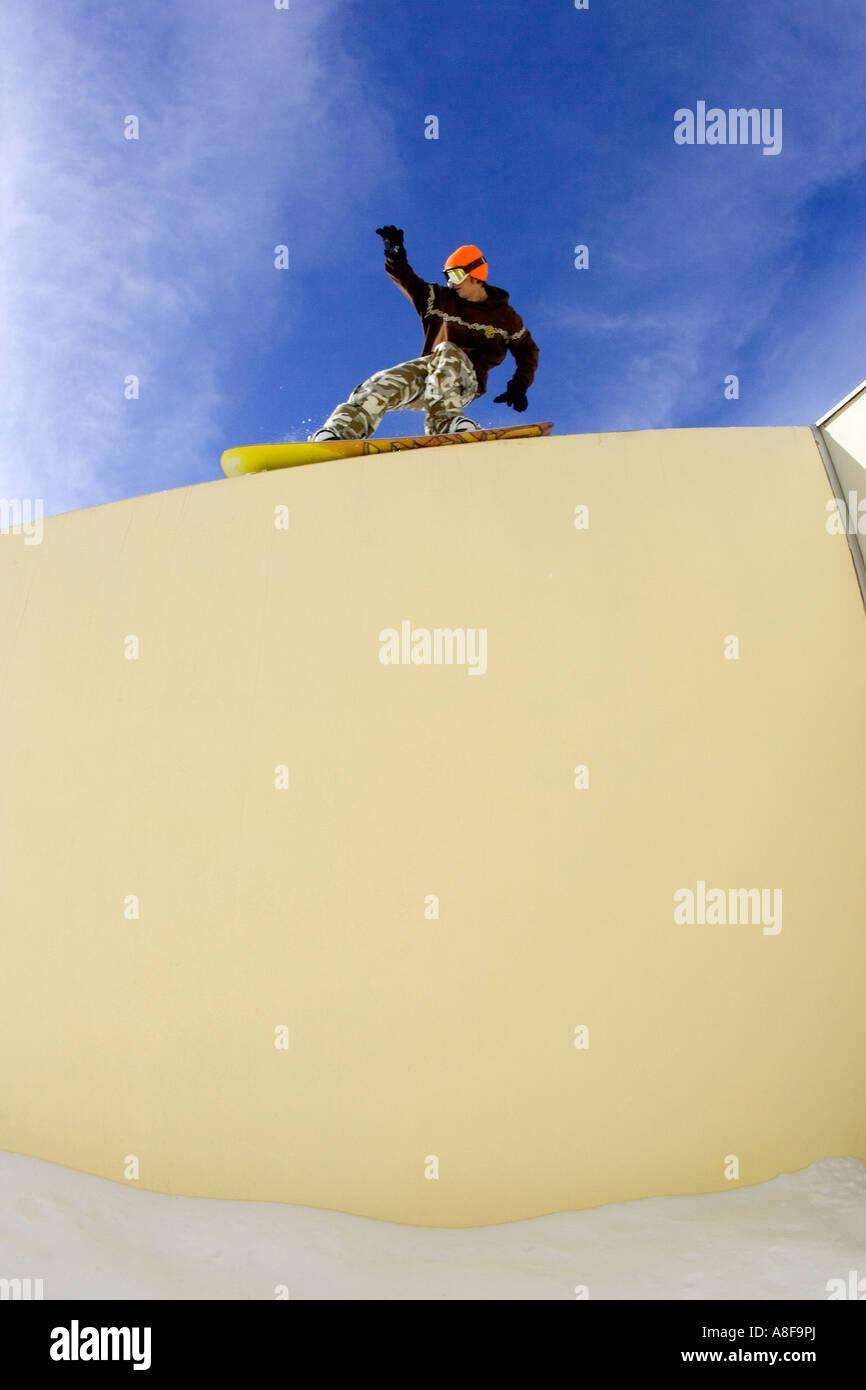 Snowboader slides a wall. Stock Photo