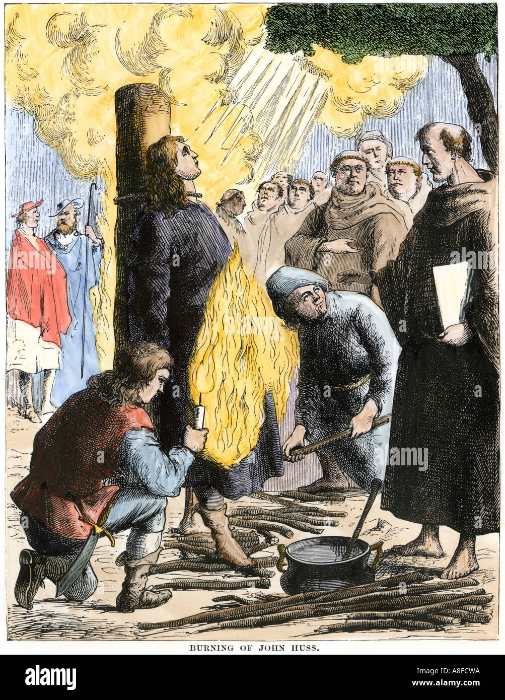 Religious reformer Jan Hus burned at the stake by the Roman Catholic Church 1415. Hand-colored woodcut - Stock Image