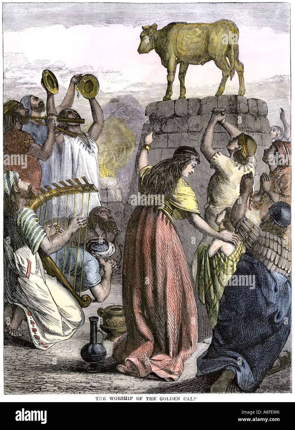 Worship of a golden calf by the Israelites in the time of Moses. Hand-colored woodcut - Stock Image