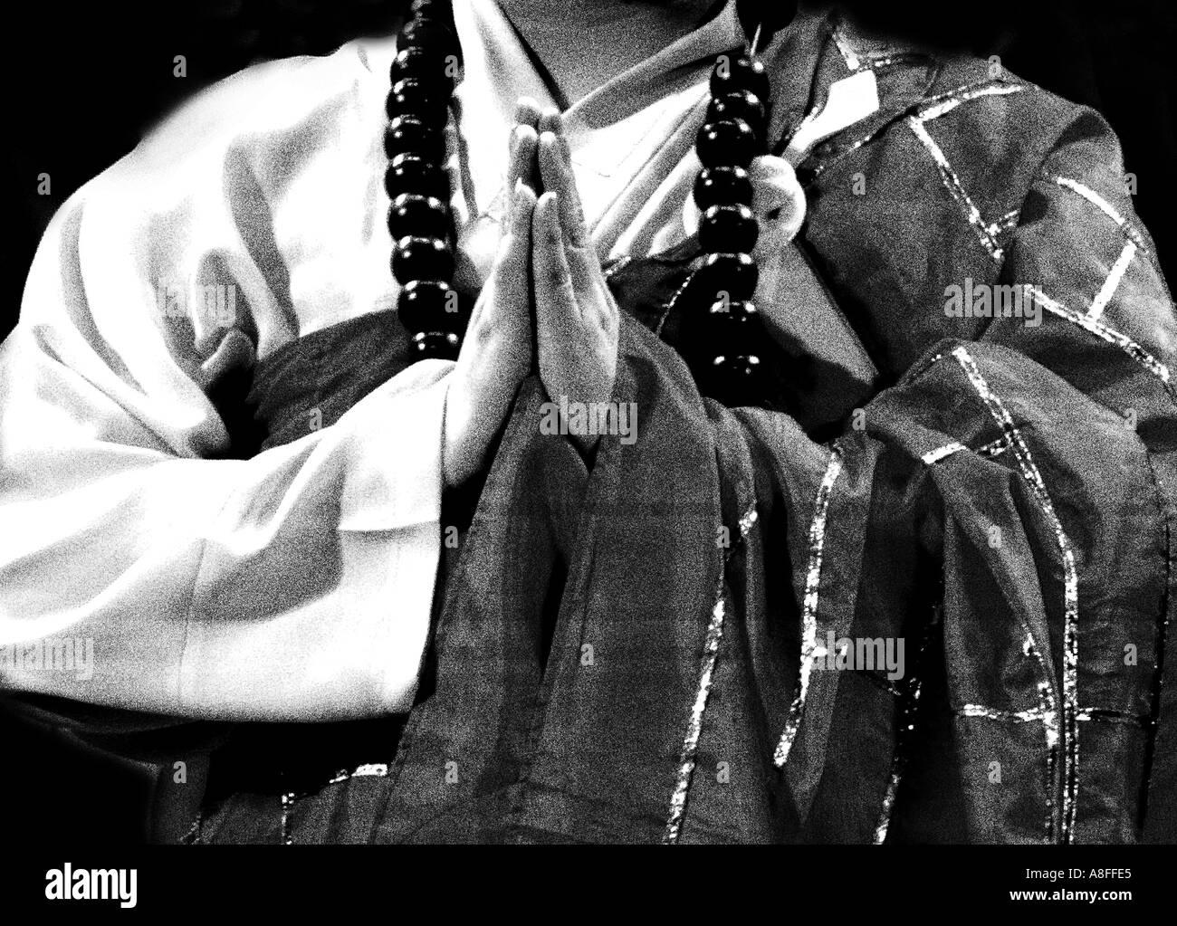 Buddhist monk praying - Stock Image