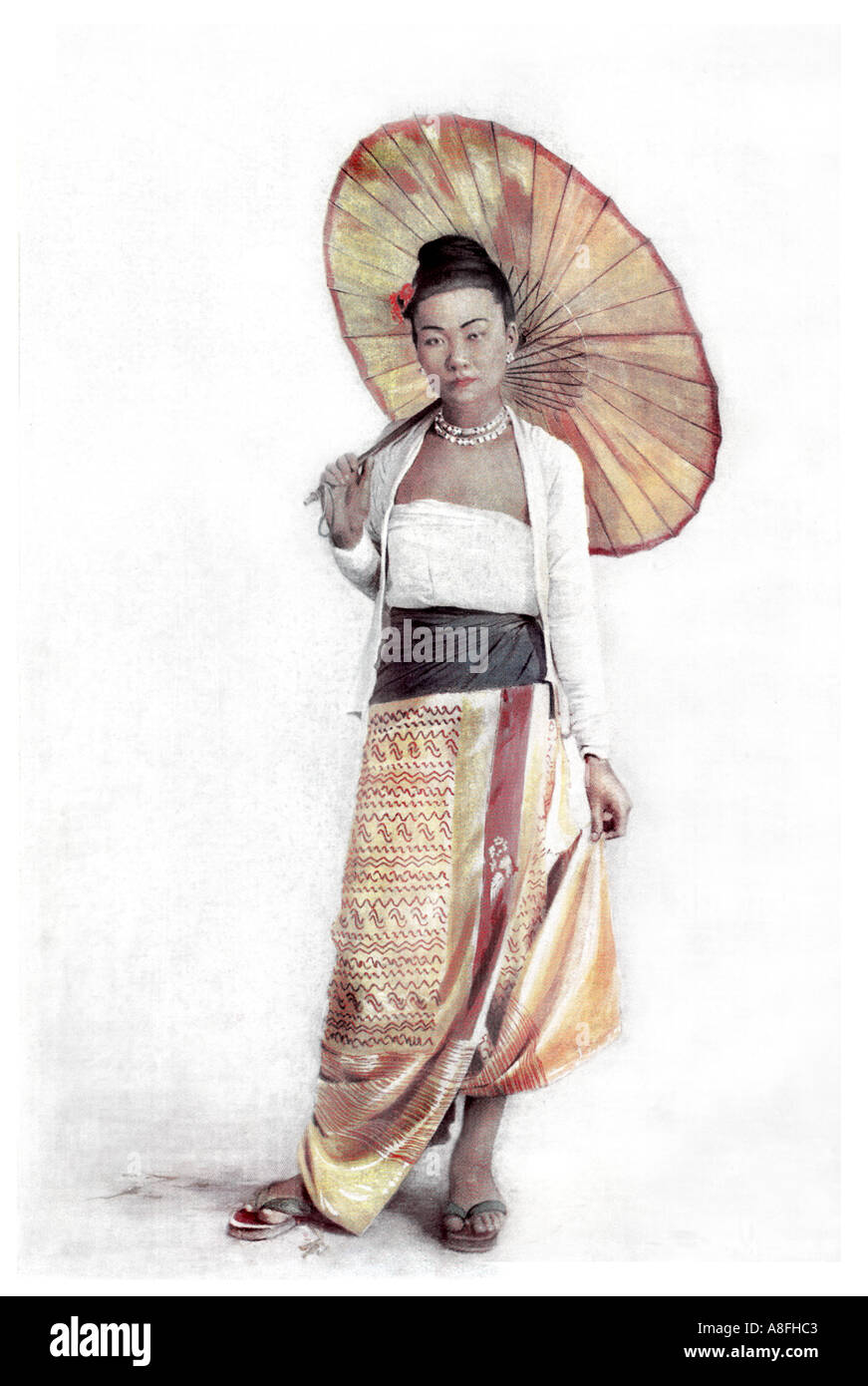 Late Nineteenth Century colour litho print depicting a Burmese lady with a Parasol Rangoon Burma Antique lithographic Stock Photo