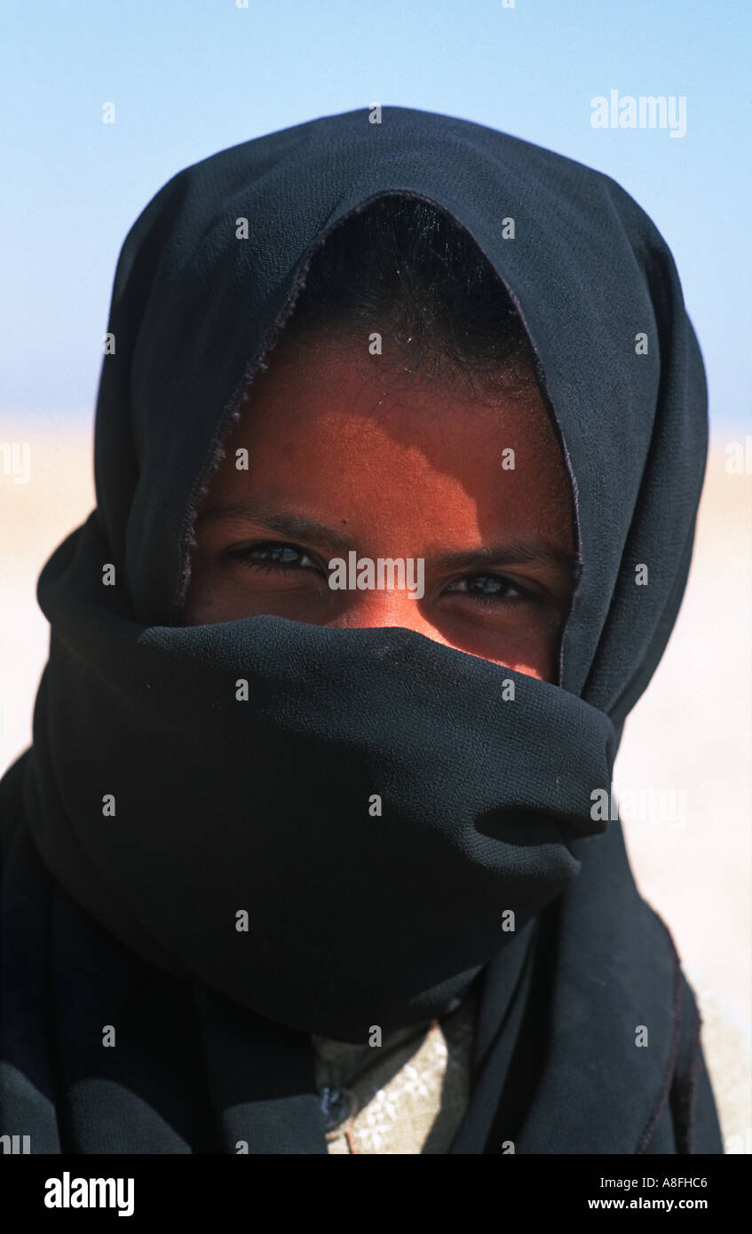 Portrait of a Bedouin girl with her face half covered with a black veil Sinai Egypt Middle East - Stock Image