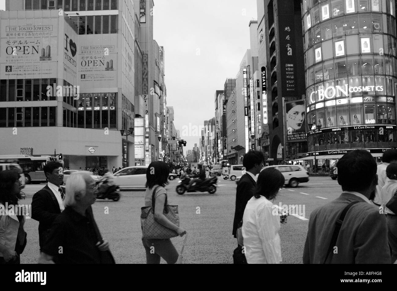 People at Crosswalk in Ginza Shopping District Tokyo Japan Stock Photo