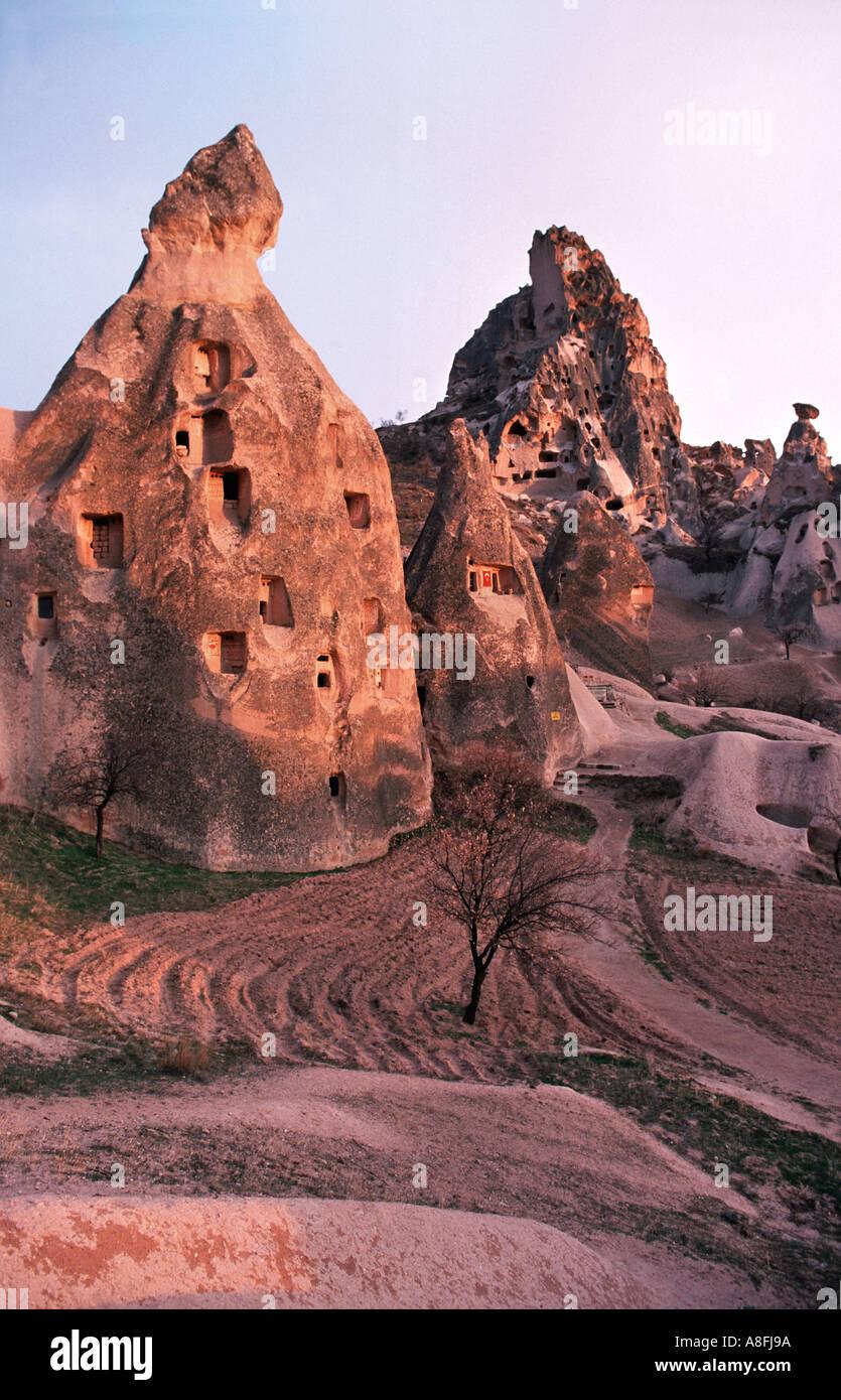 Cappadocia a surrealistic landscape of cones pillars hollowed out dwellings Uchisar Cappadocia Central Anatolia Turkey - Stock Image