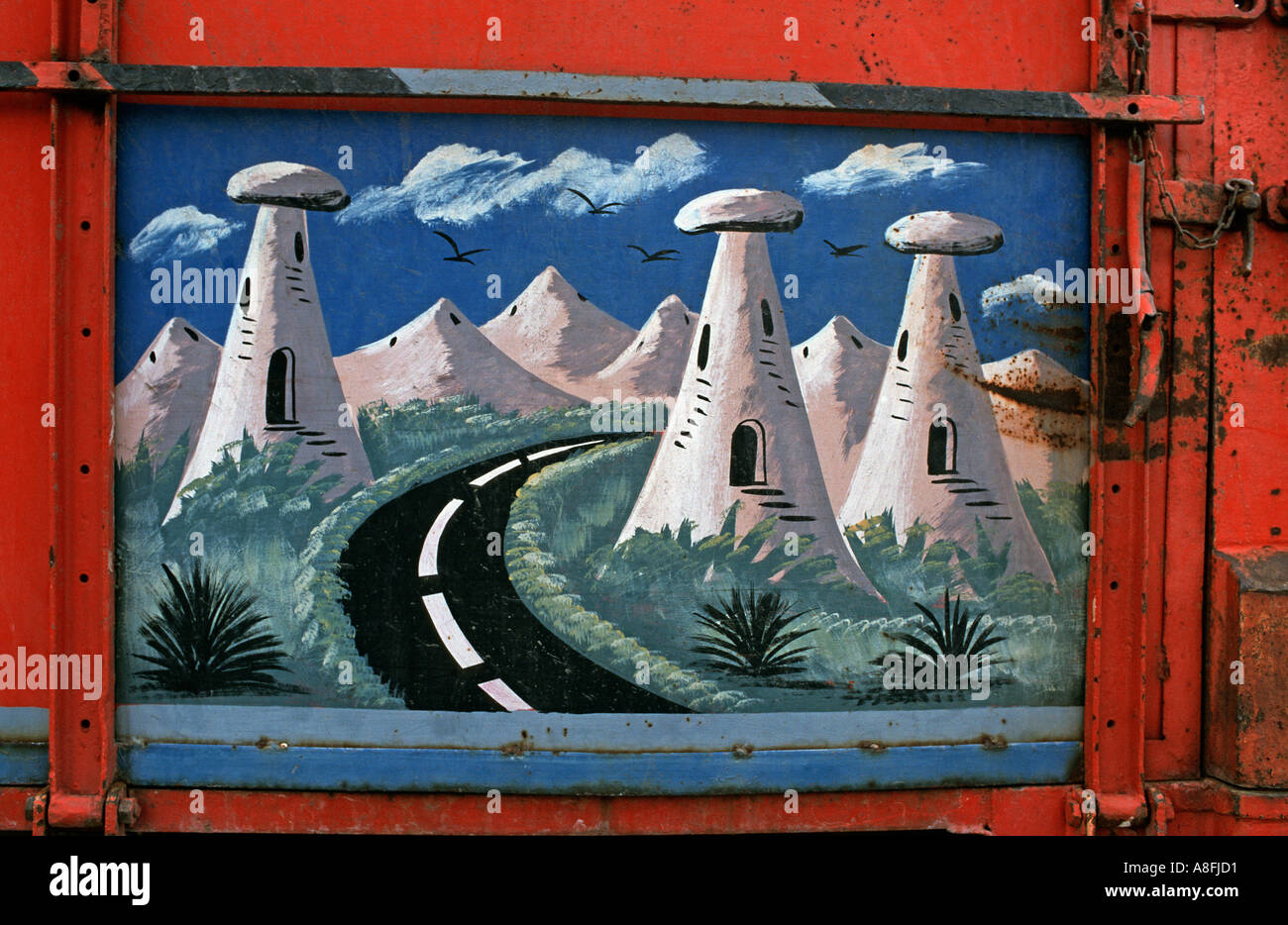 Detail of a handpainted panel of a Turkish lorry depicting the fairy chimneys of Cappadocia Central Anatolia Turkey - Stock Image