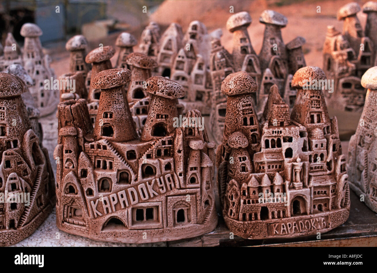 Tourist souvenirs carved and cast in the likeness of some of the highlights of Cappadocia Central Anatolia Turkey - Stock Image