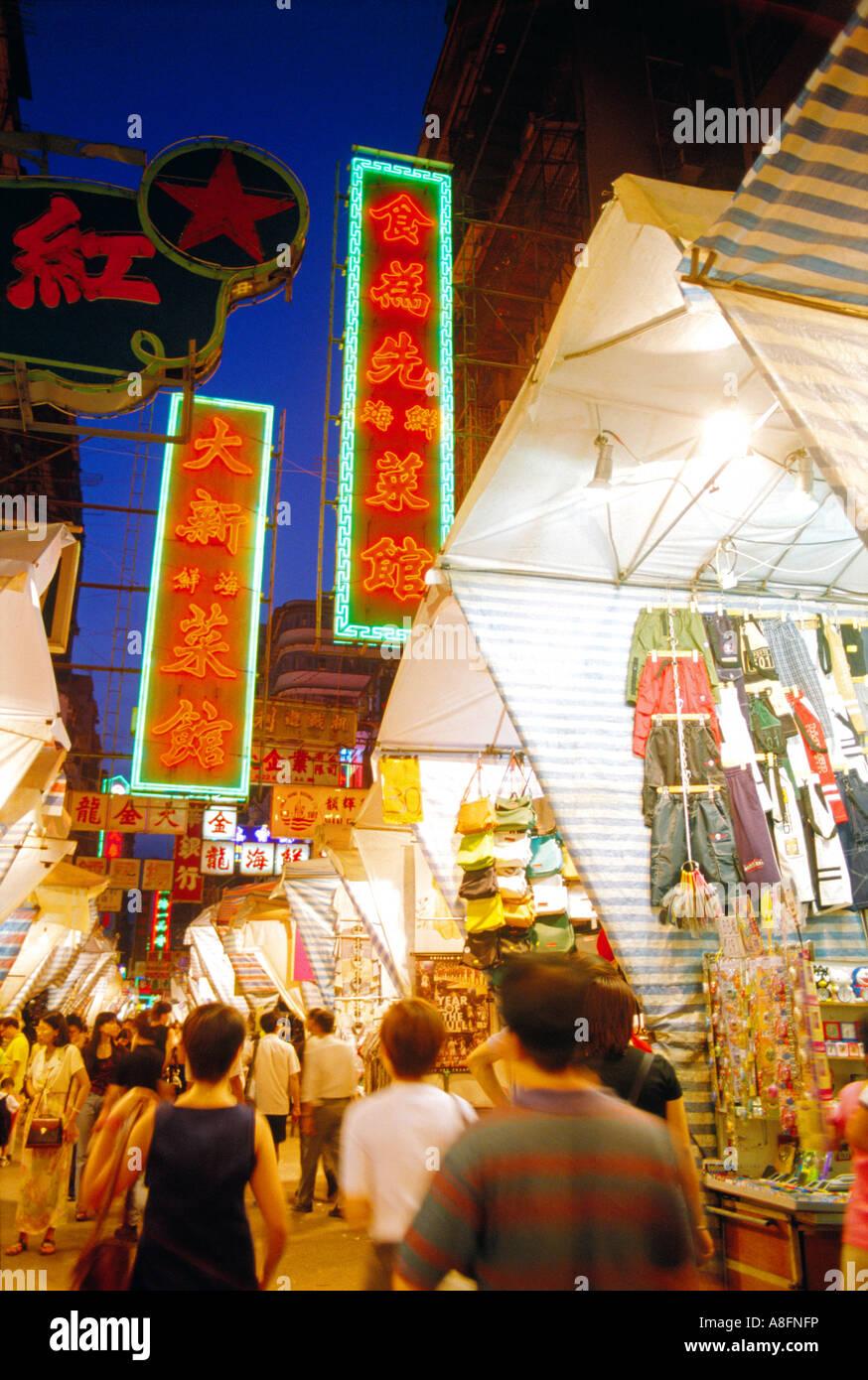 Woman street lady street night market yaumatei Mongkok kowloon hong kong china - Stock Image