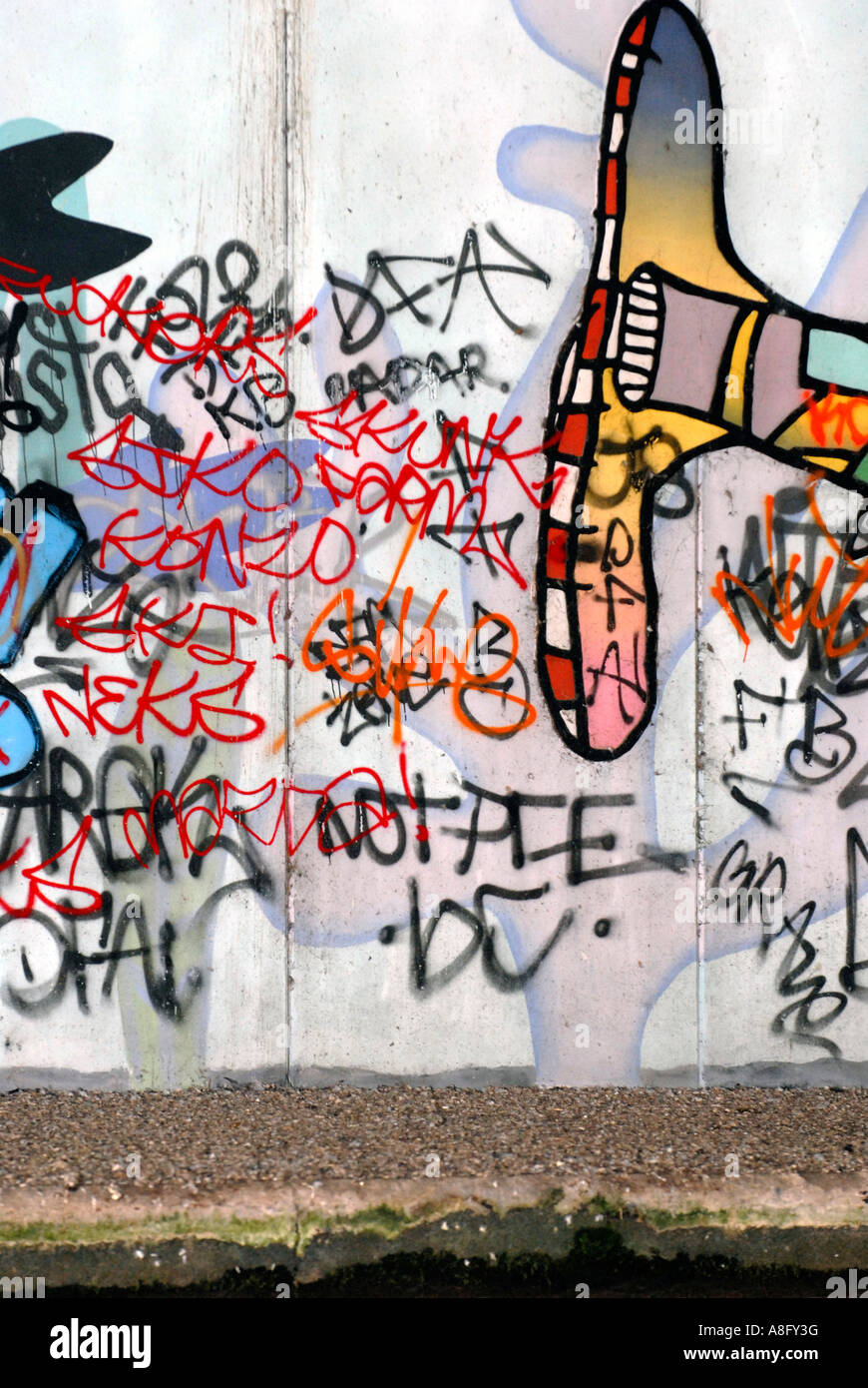 graffitti over painted mural in canalside subway - Stock Image