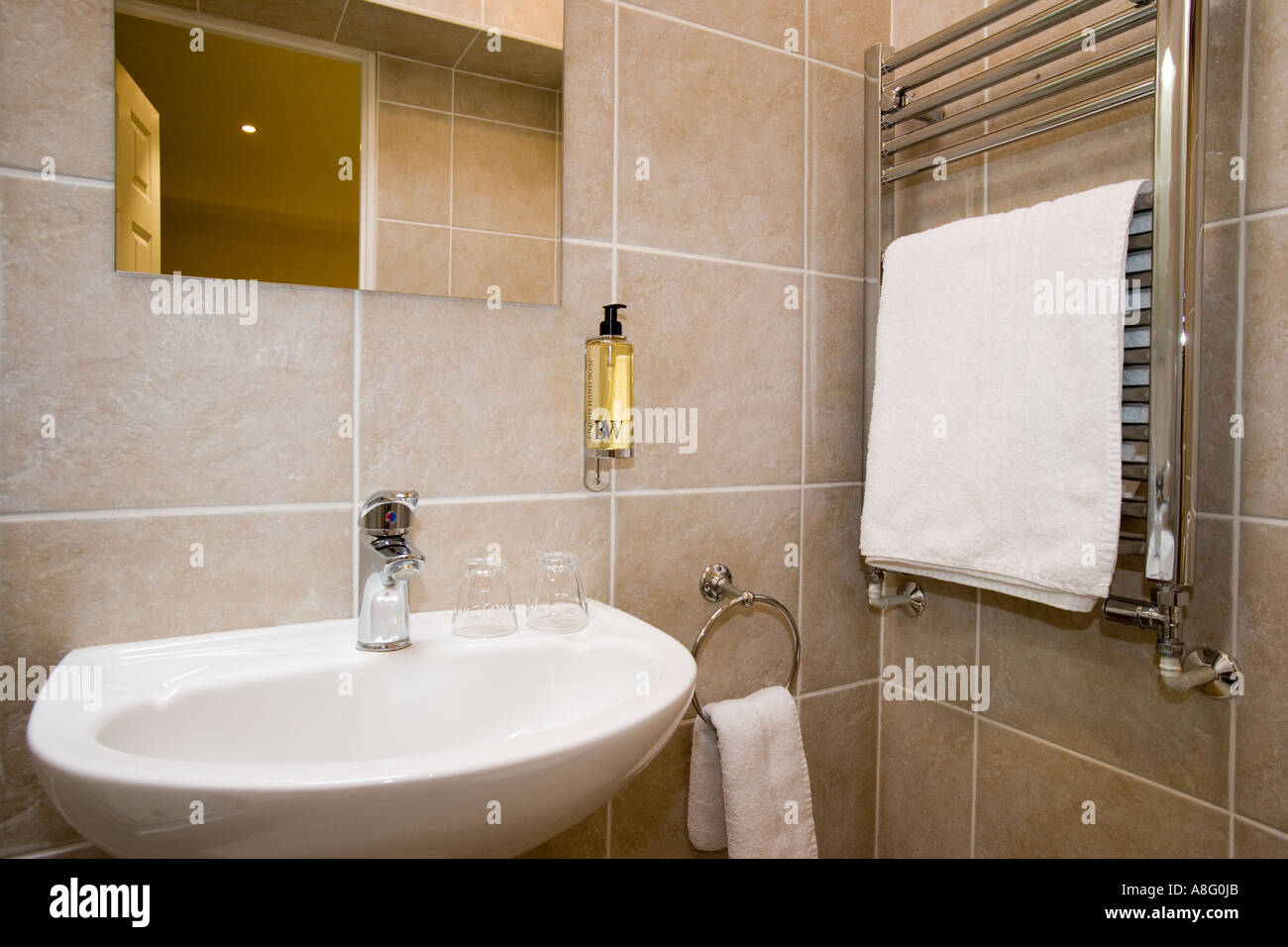 Lovely Bathroom Sink With Wall Mounted Soap Dispenser And Towel Rail