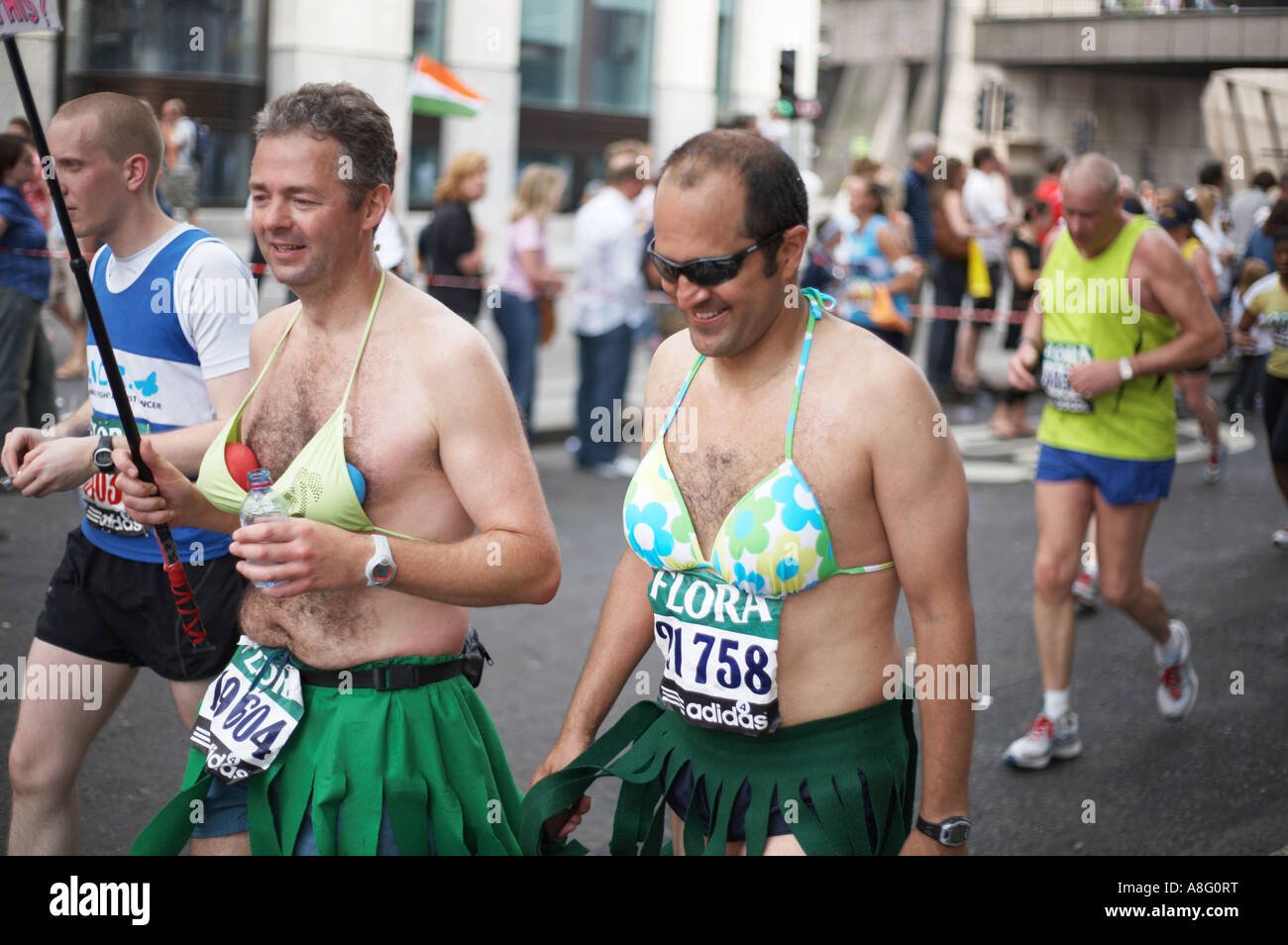 London Marathon runners in bras and skirts 2007 - Stock Image