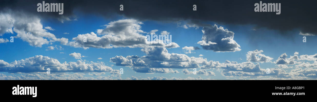 rain and grey clouds on a bright blue sky, Sweden - Stock Image