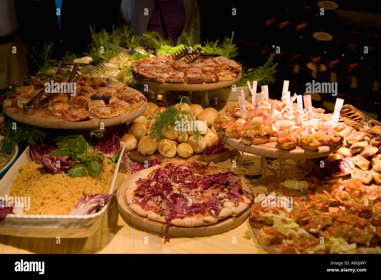 Antipasti plates of pizza and bruschetta at bar Palermo Sicily Italy - Stock Image
