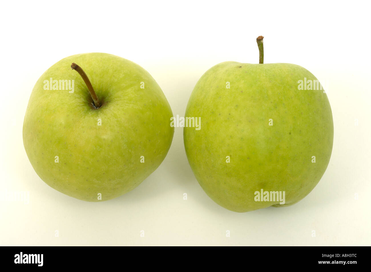 Golden Delicious apples supermarket bought and in normal shop condition - Stock Image