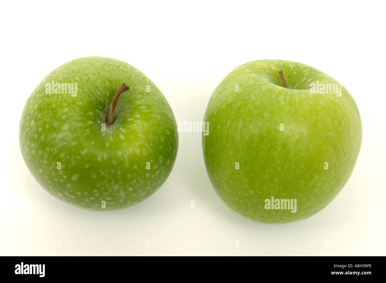 Granny Smith apples supermarket bought and in normal shop condition - Stock Image