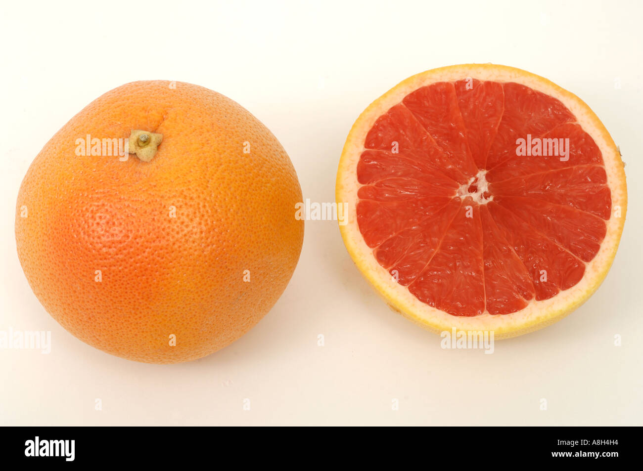 Red grapefruit supermarket bought and in normal shop condition - Stock Image