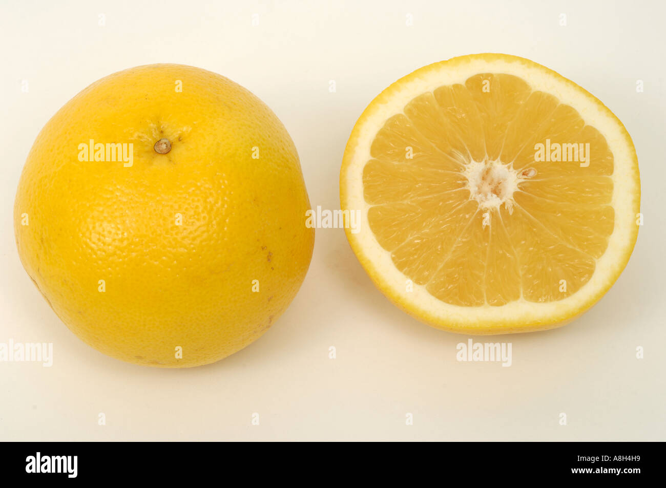 Yellow grapefruit supermarket bought and in normal shop condition - Stock Image