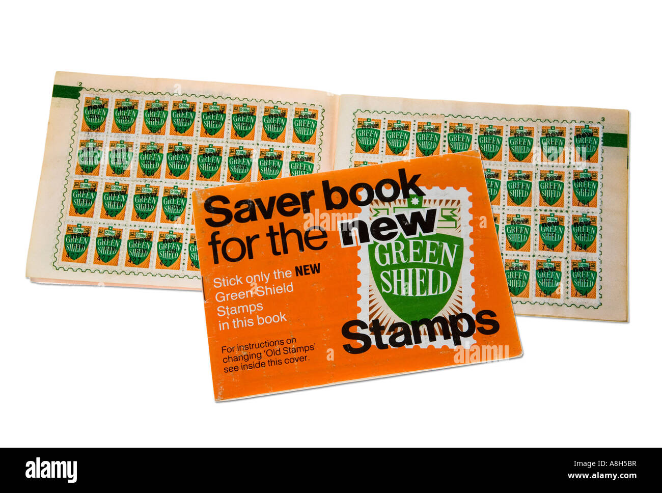 Green Shield stamps in book from 1970s used to collect points from purchases in petrol stations and shops UK - Stock Image