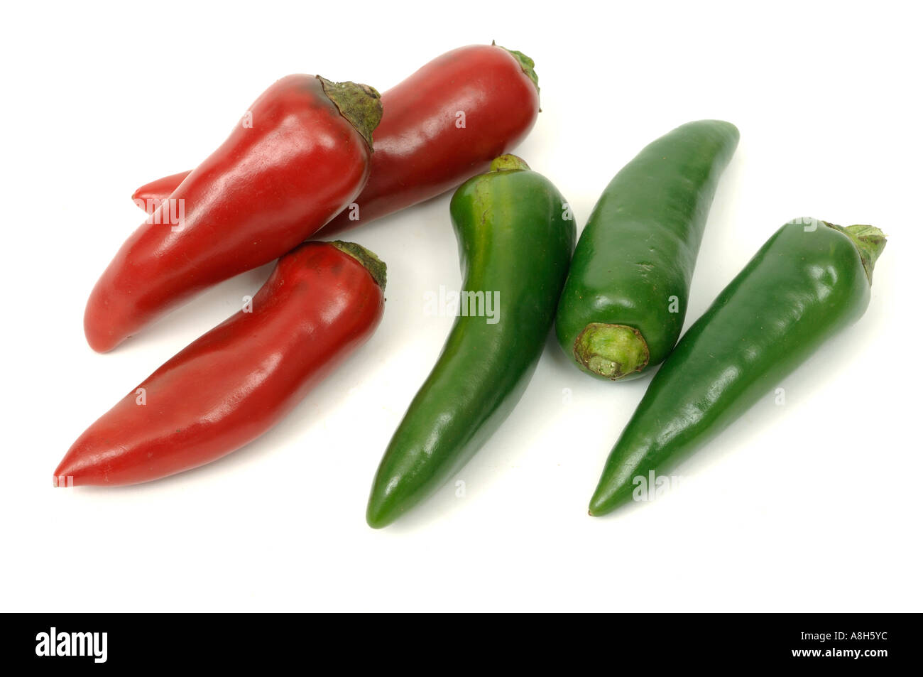 Vegetable produce typical supermarket bought red green chili peppers Stock Photo