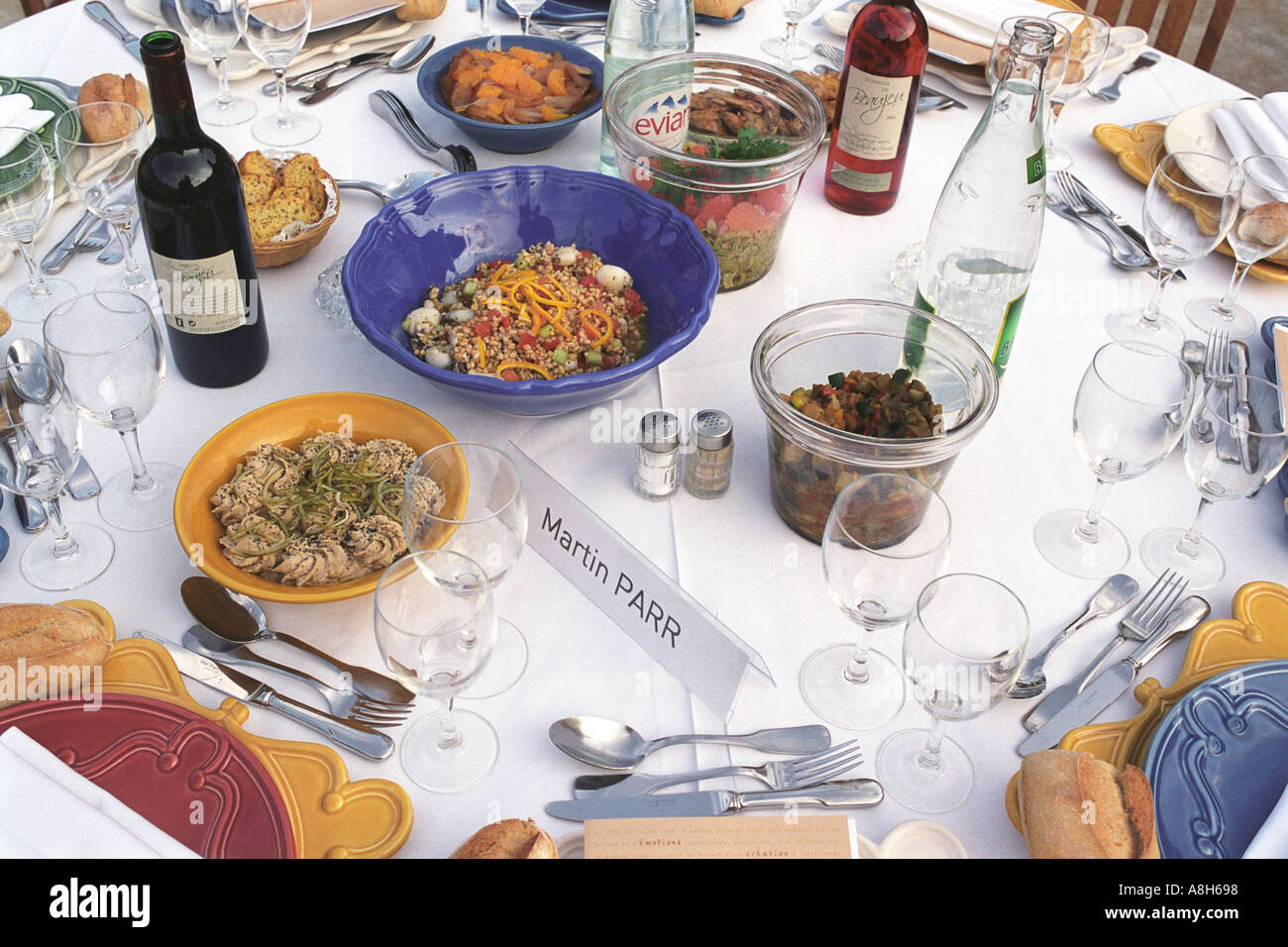 Martin Parr Magnum photographer table at dinner party Arles France HOMER SYKES - Stock Image