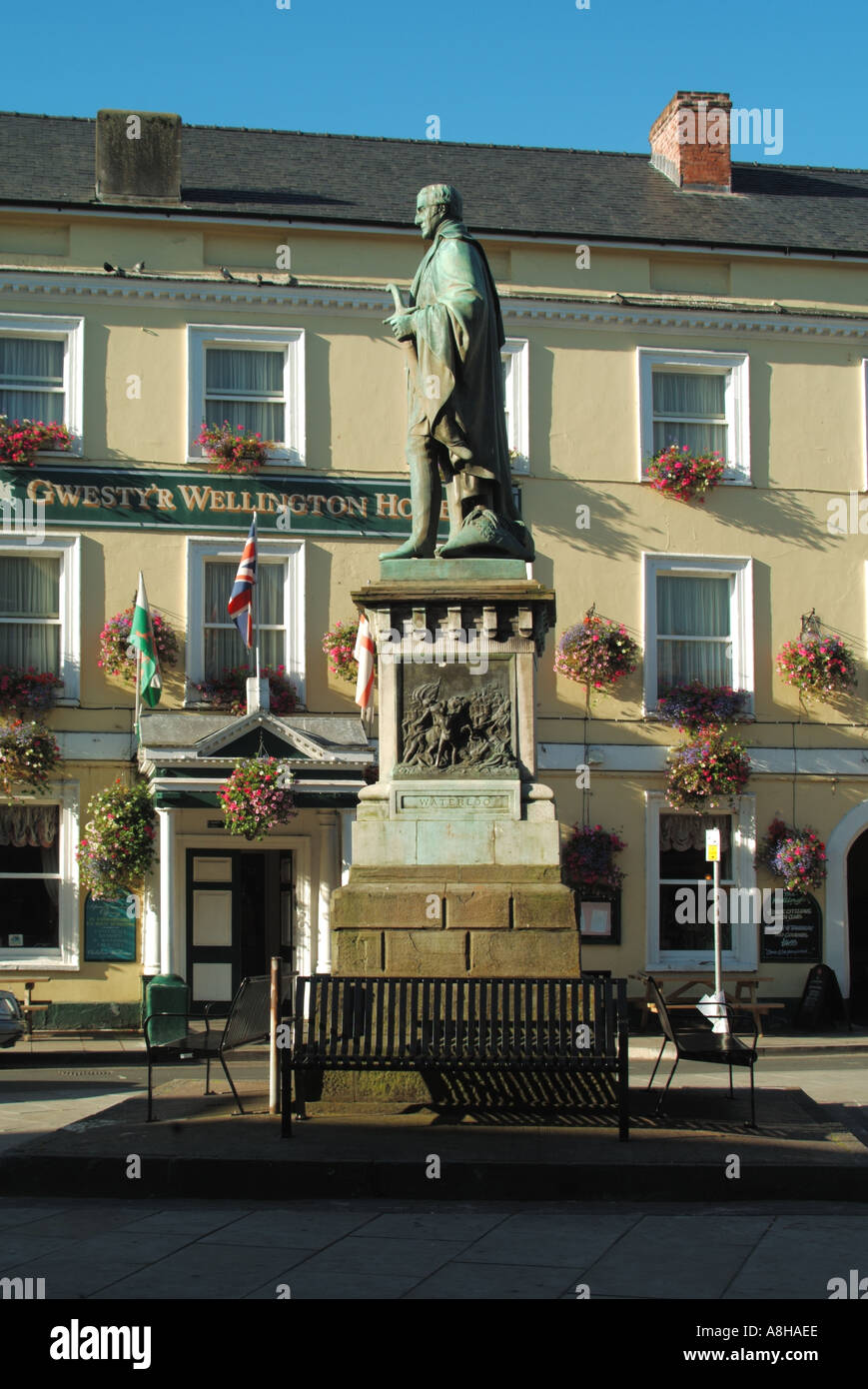 Brecon town centre full length statue on plinth of Arthur Wellesley 1st Duke of Wellington with Wellington hotel beyond Powys Wales UK - Stock Image