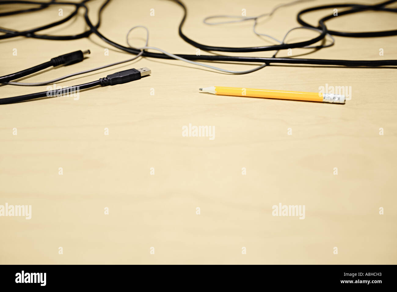 Yellow Pencil And Computer Cables On Desktop - Stock Image