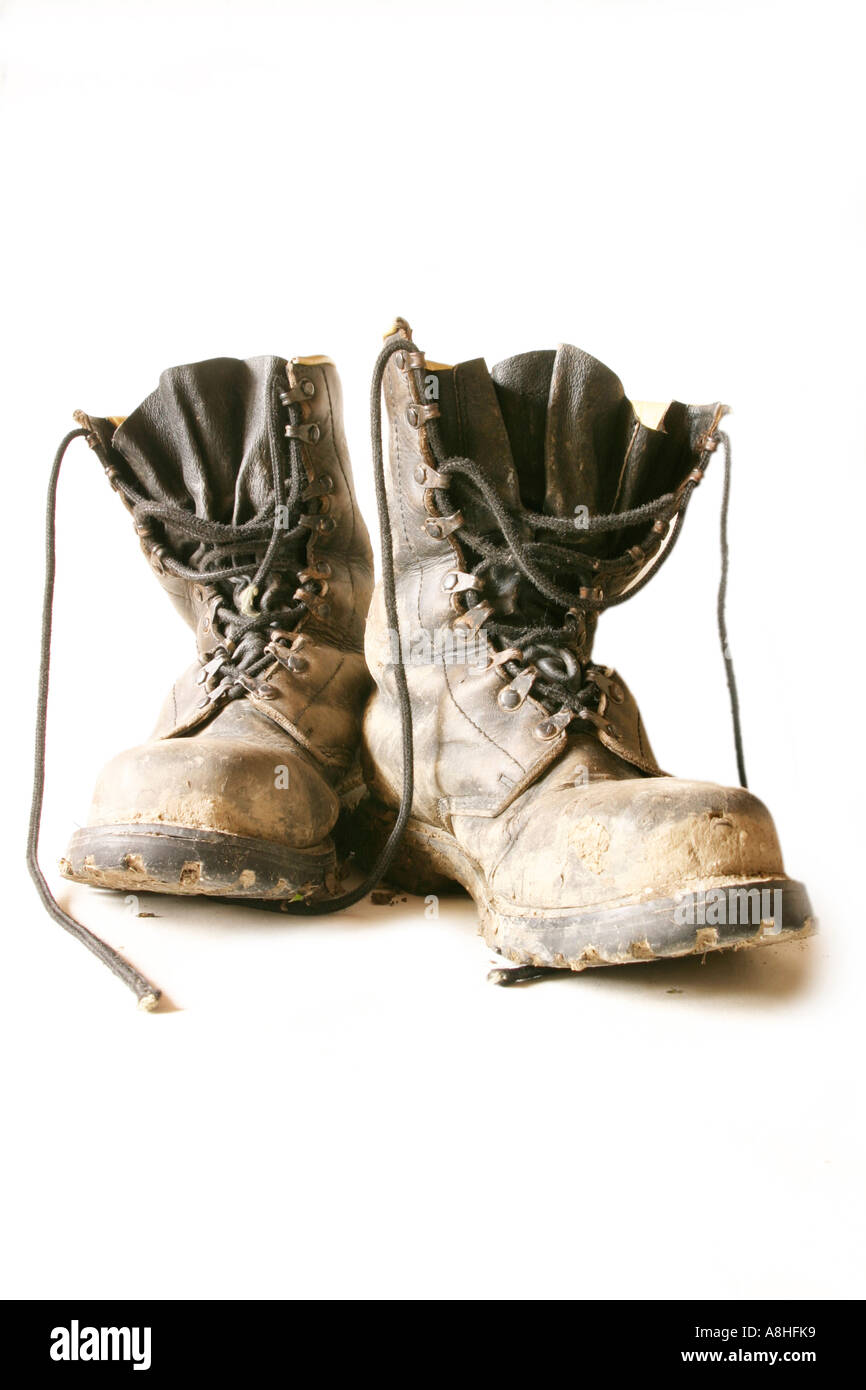 Dirty leather boots - Stock Image
