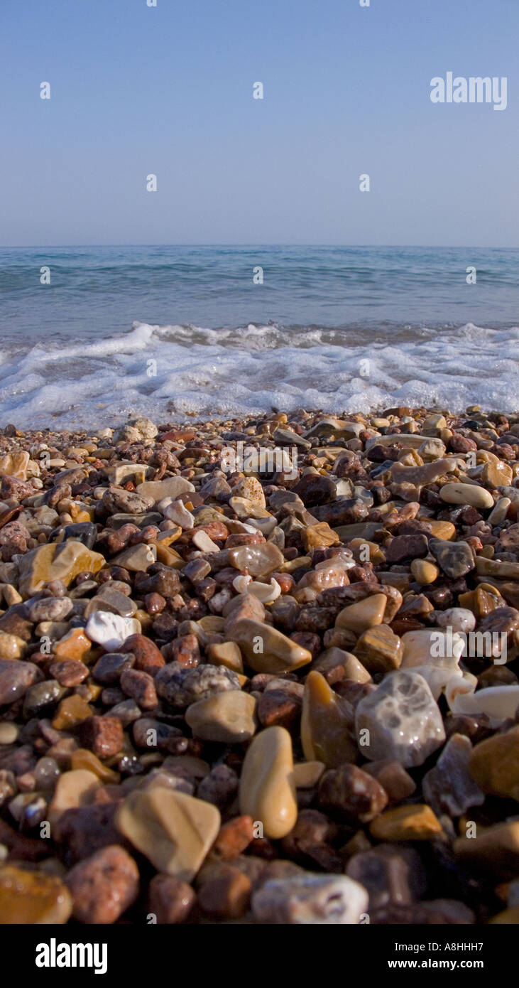 Close up of the shingle and water at the shoreline Nuweiba on the Red Sea Coast Sinai Egypt - Stock Image