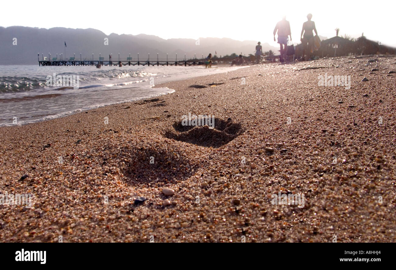 Footprint in the shingle at Nuweiba on the Red Sea Coast Nuweiba port and surrounding mountains Sinai Egypt - Stock Image
