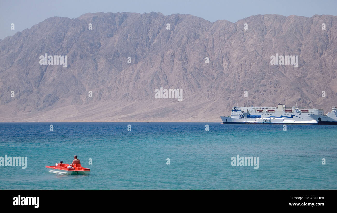 Holidaymakers on a pedalo Father and son at Nuweiba on the Red Sea Coast Nuweiba port and surrounding mountains Sinai Egypt - Stock Image