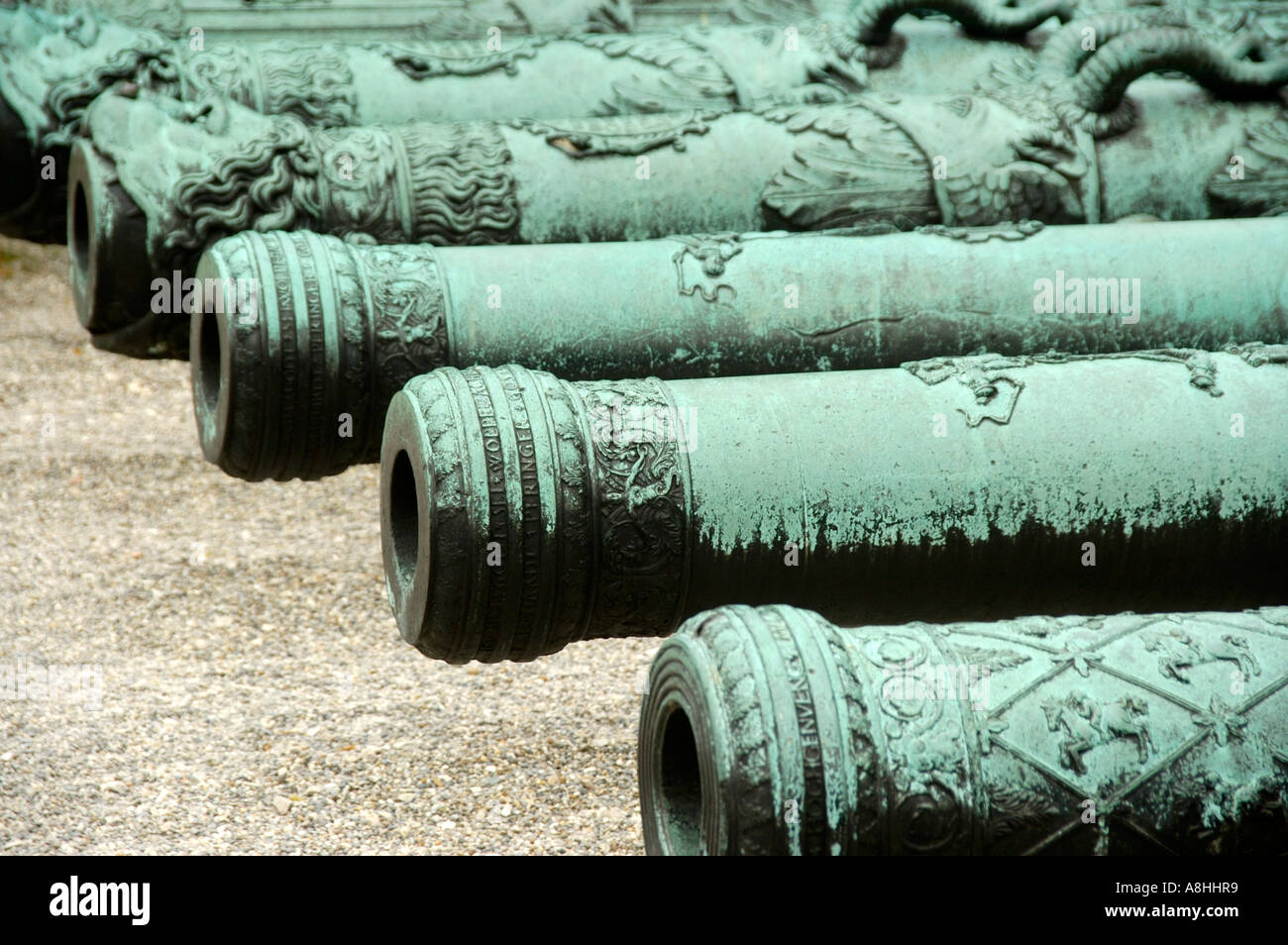 Patina covered old cannons in front of the castle Ingolstadt Bavaria Germany - Stock Image