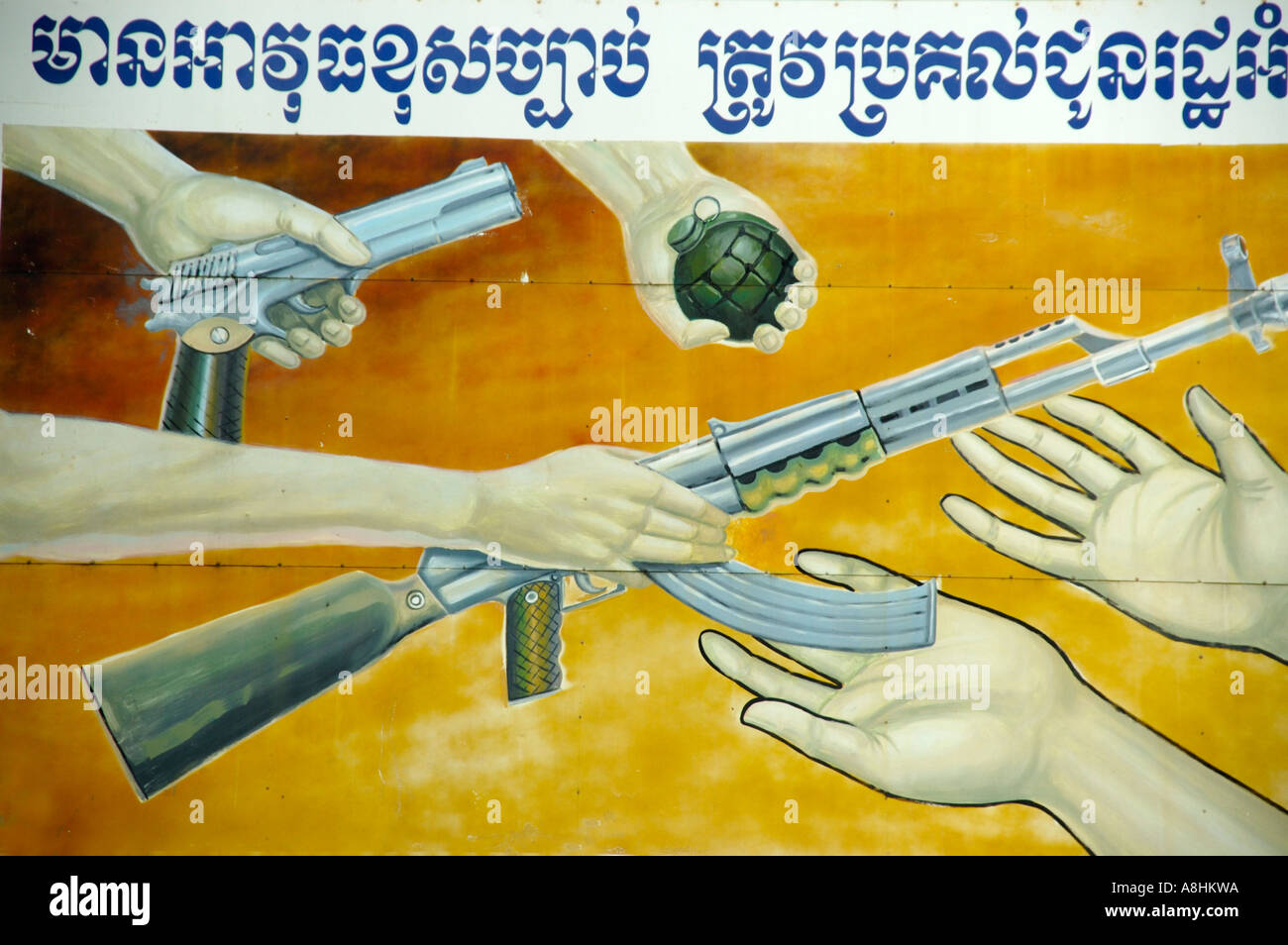 Sign in Khmer script returning all weapons Cambodia - Stock Image