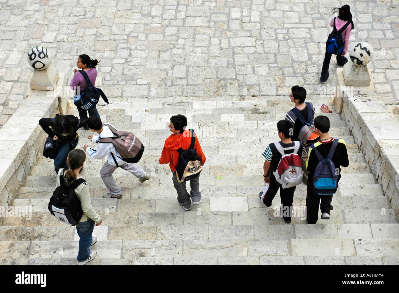 School kids with rucksack going down stairs, Graffiti, Alicante, Spain Stock Photo