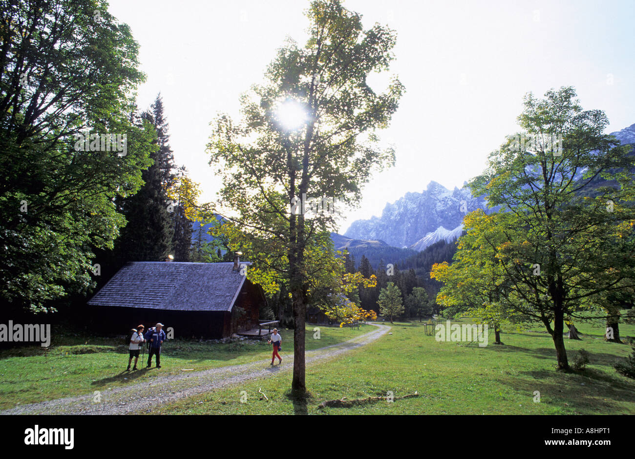 Thee hikers near the Puerschhaus at Kleiner Ahornboden Germany - Stock Image