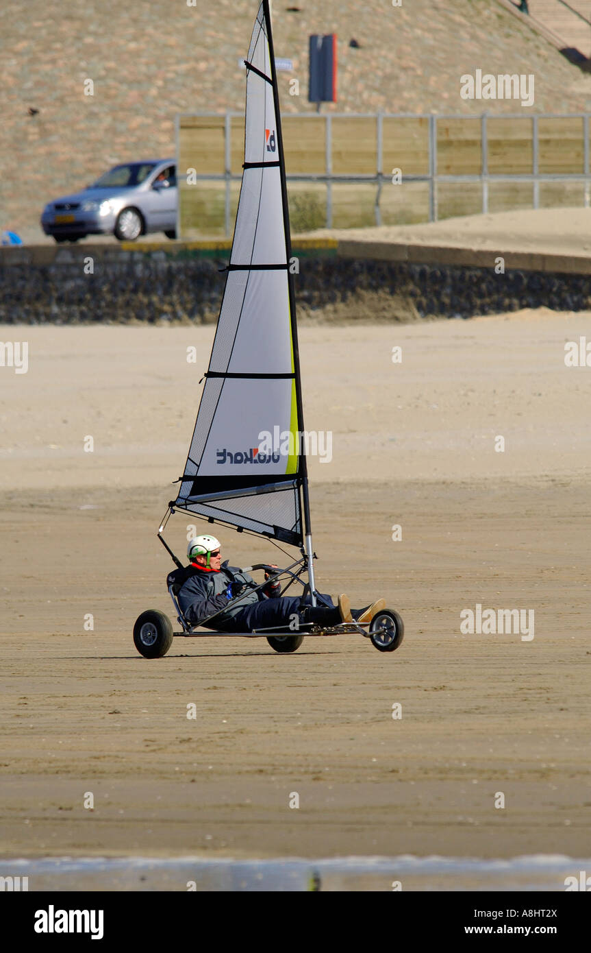 Blow car on the beach from city place Scheveningen Zuid Holland with mid age men Stock Photo