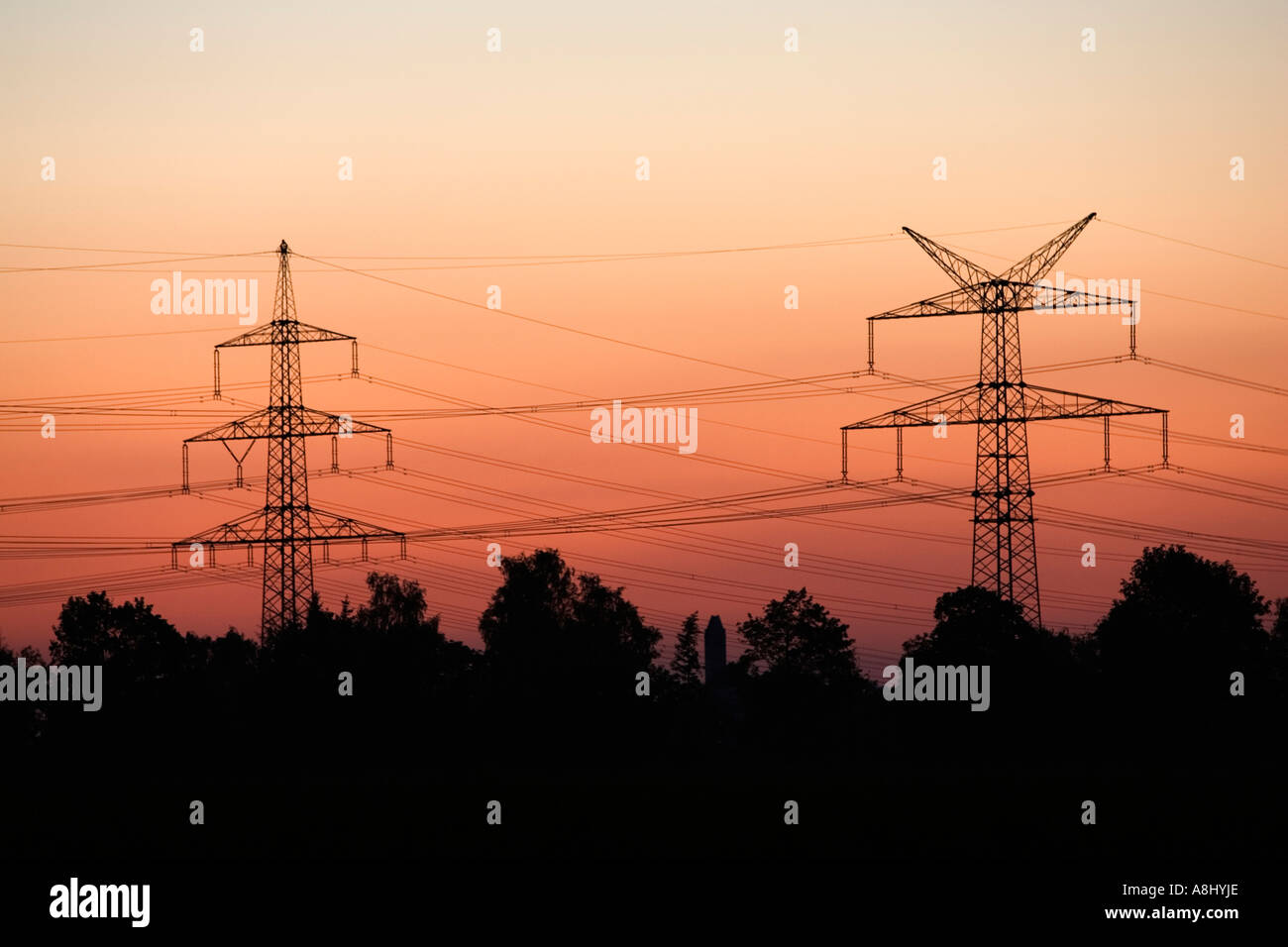 Pylon in front of red sky in the evening - Stock Image
