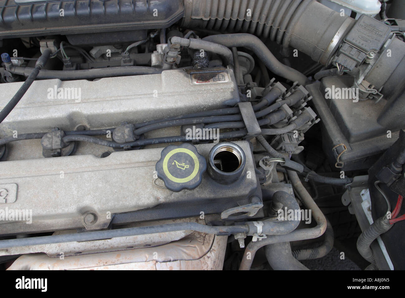 Before checking or servicing in the engine compartment