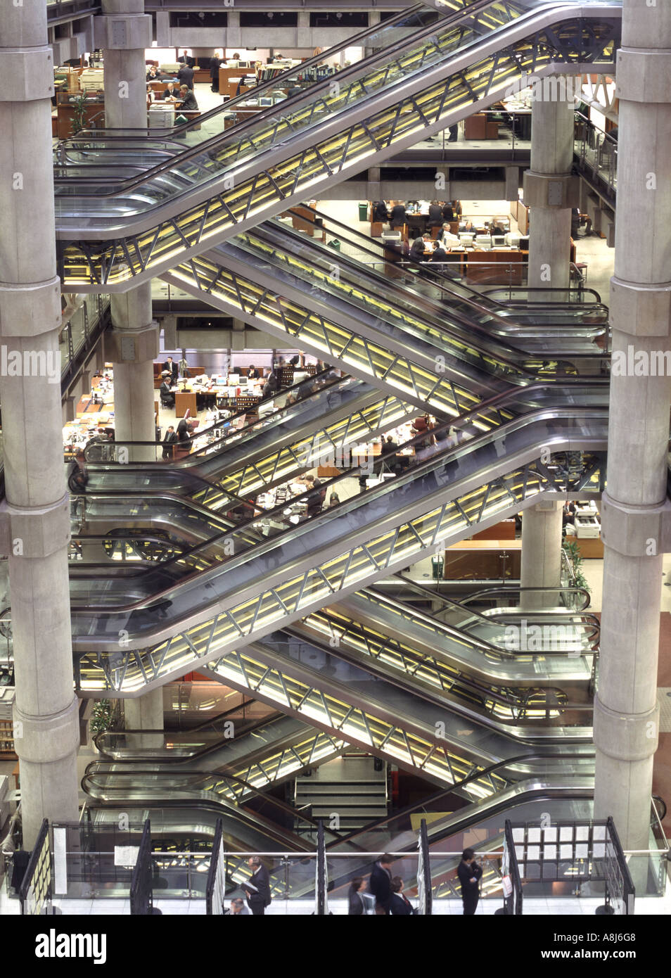 Lloyds of London City of London interior view of escalator system in midst of open plan office workspaces England UK - Stock Image