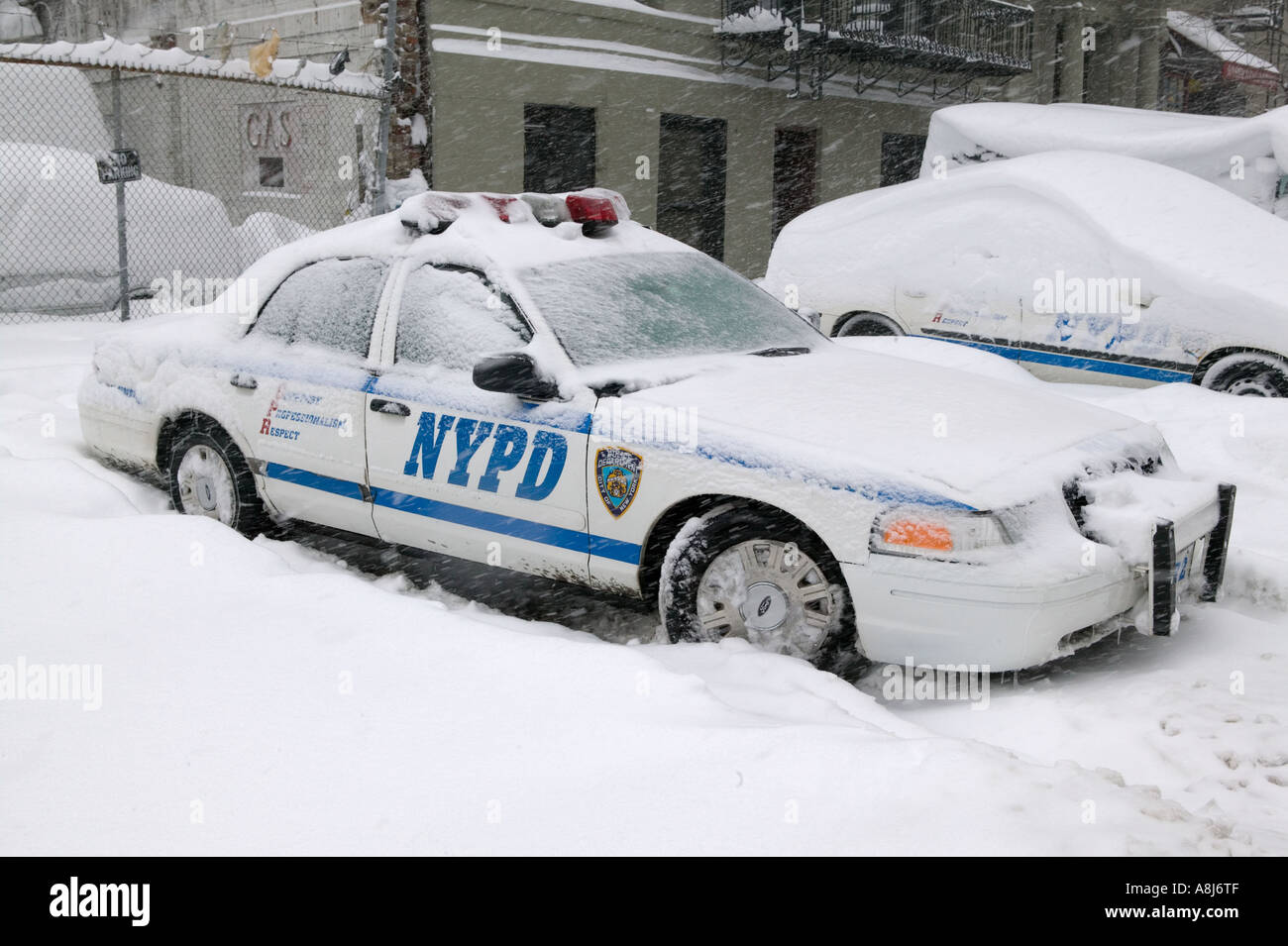 An Nypd Cruiser Sits Covered In Snow During A Storm In New York City Usa February