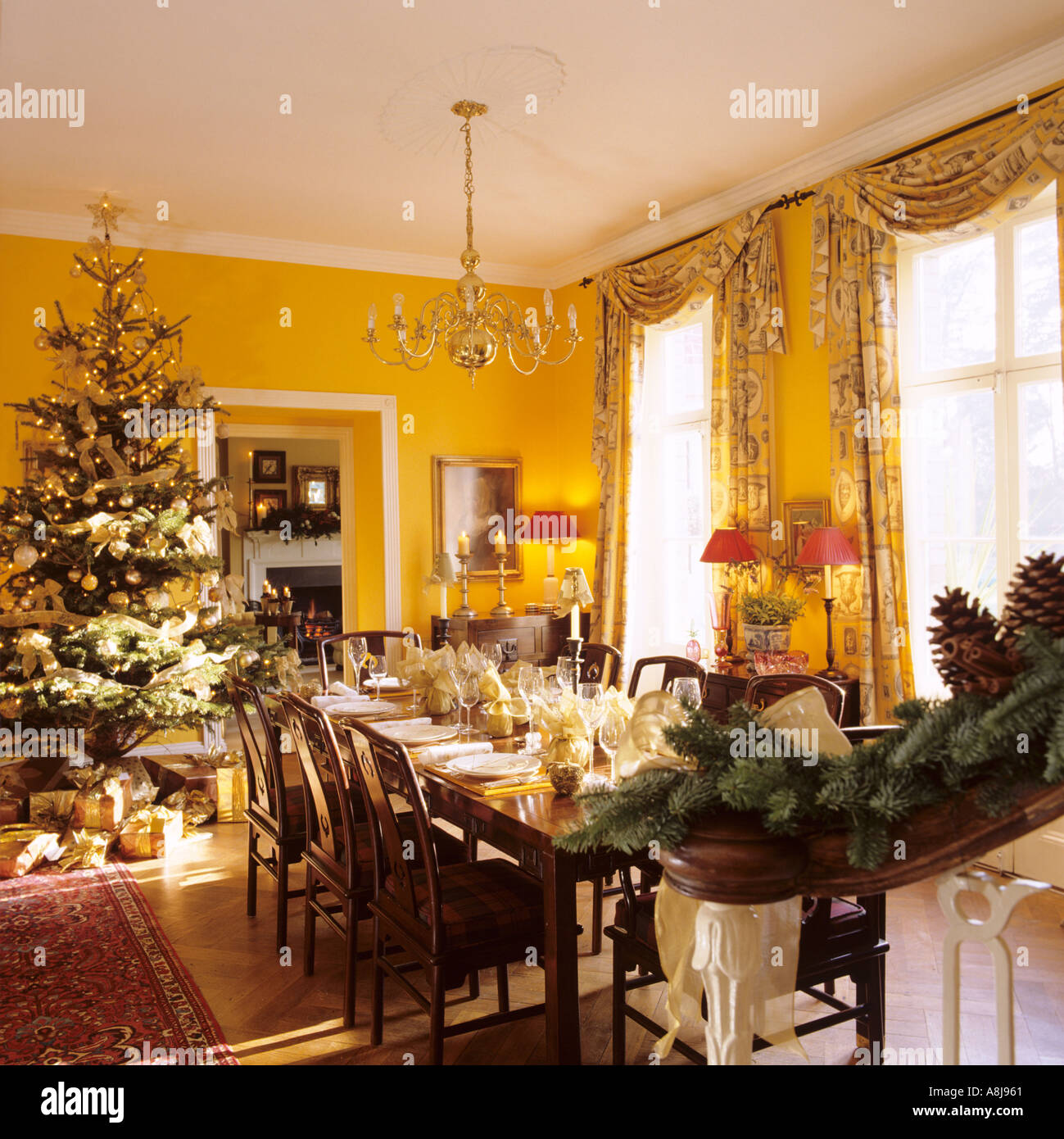 christmas dinner table set with tree stock image