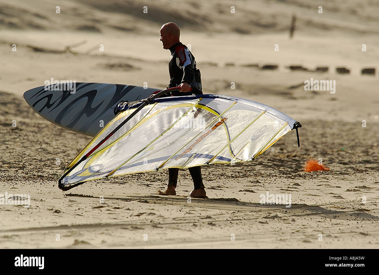 Windsurfing men on the beach Place Domburg Sealand Nederland North sea nordsee - Stock Image