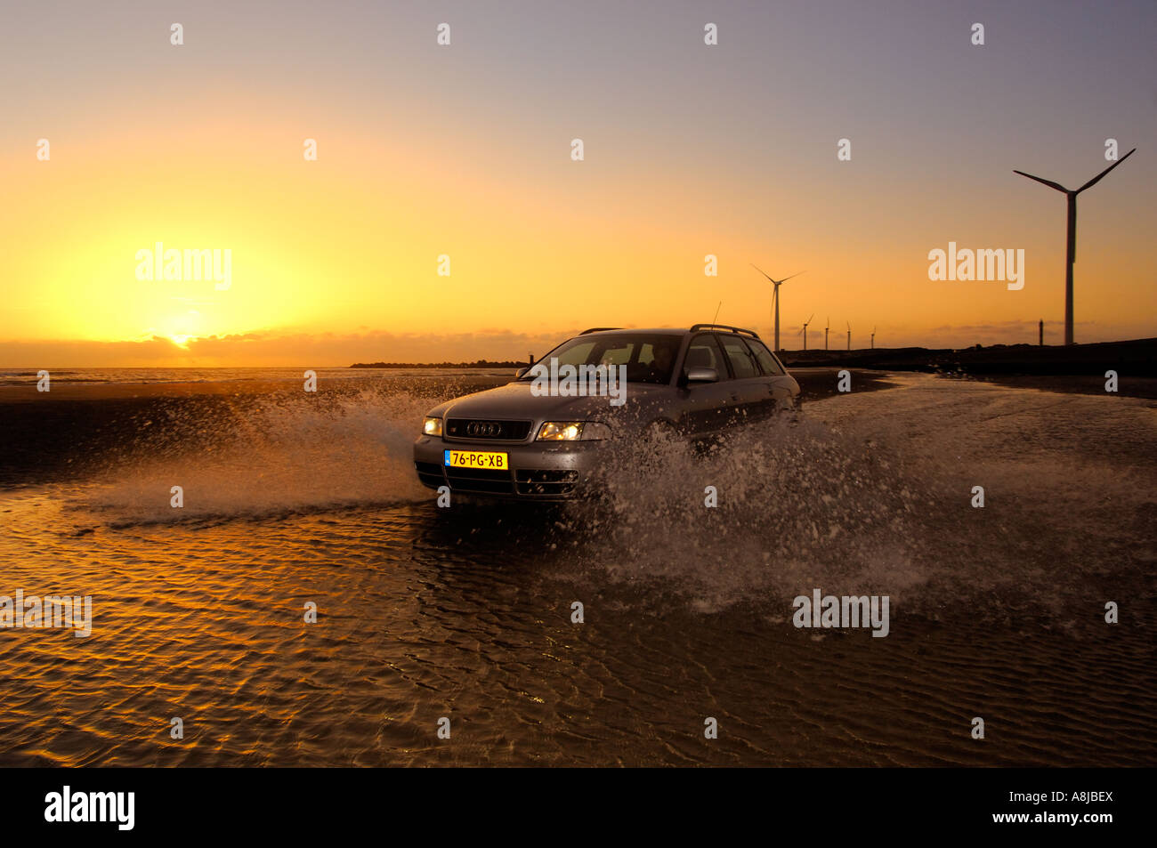 Audi S4 wagon car V6 Biturbo engine 2000 2001 Germany in full action on the beach A4 Quarter sunset driving beach Stock Photo