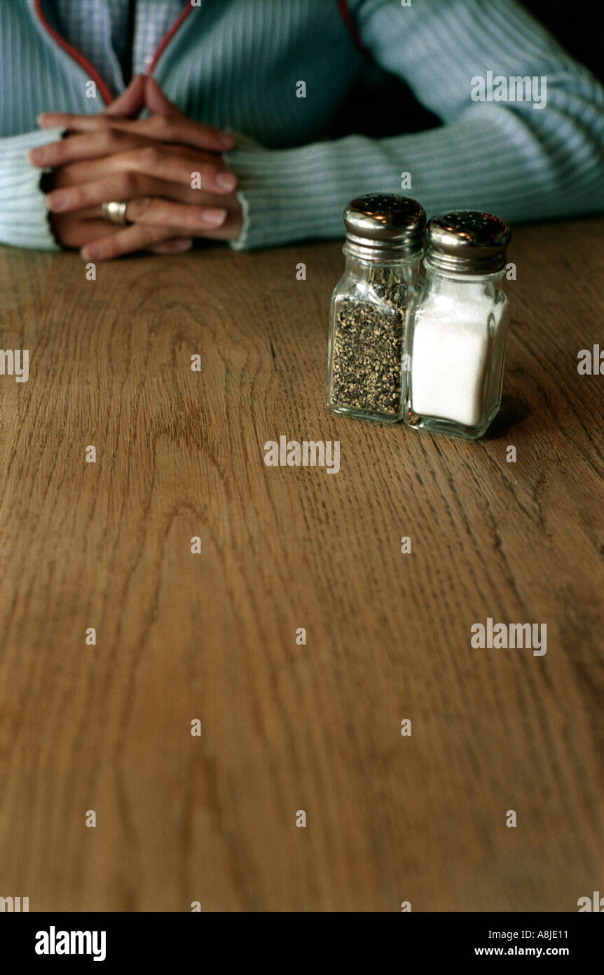 A woman waiting for dinner in a restaurant Stock Photo
