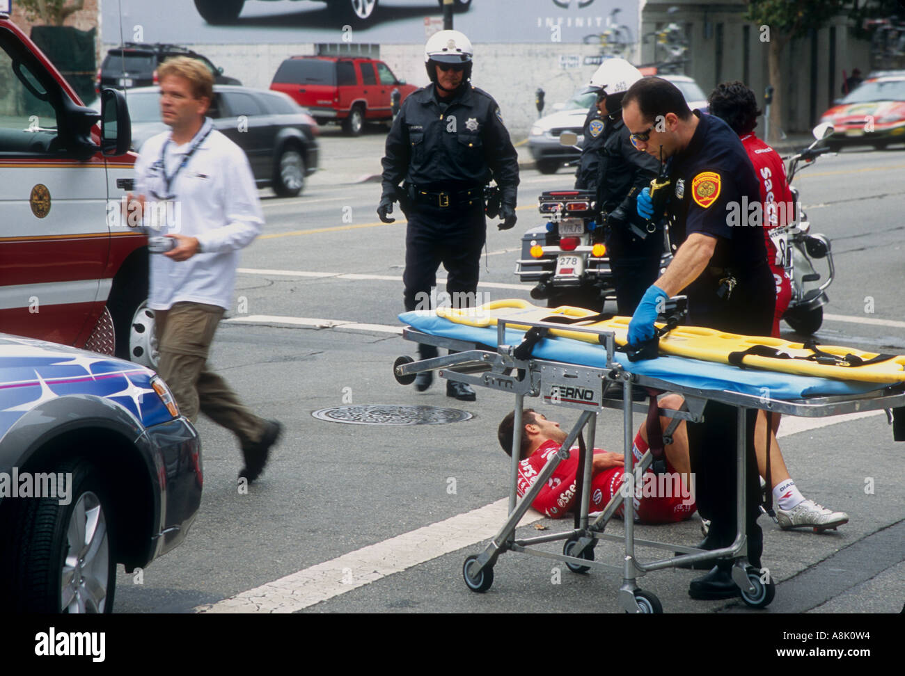 Cyclist involved in the San Francisco Grand Prix of Cycling 2004 after an accident during the race. - Stock Image