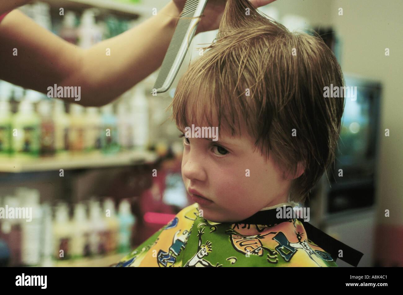 Sad Young Girl Getting A Haircut Stock Photo 2241728 Alamy
